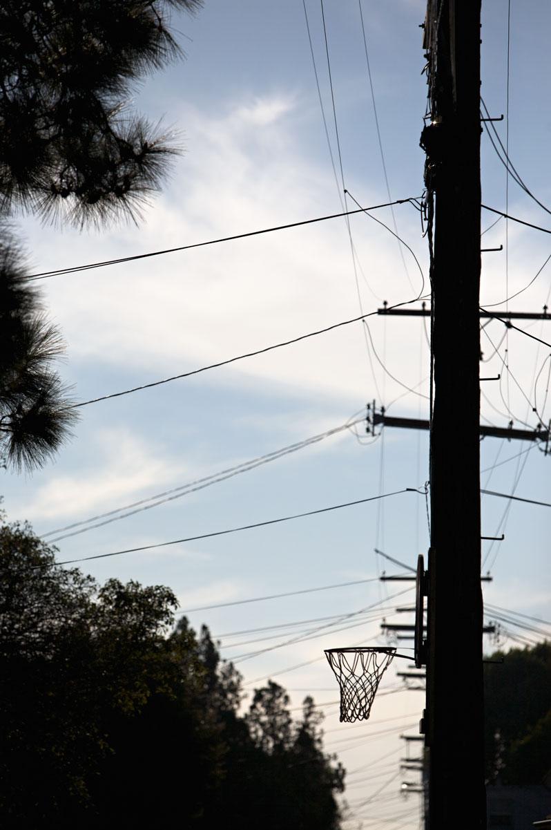 Photo of basketball hoop around a telephone pole