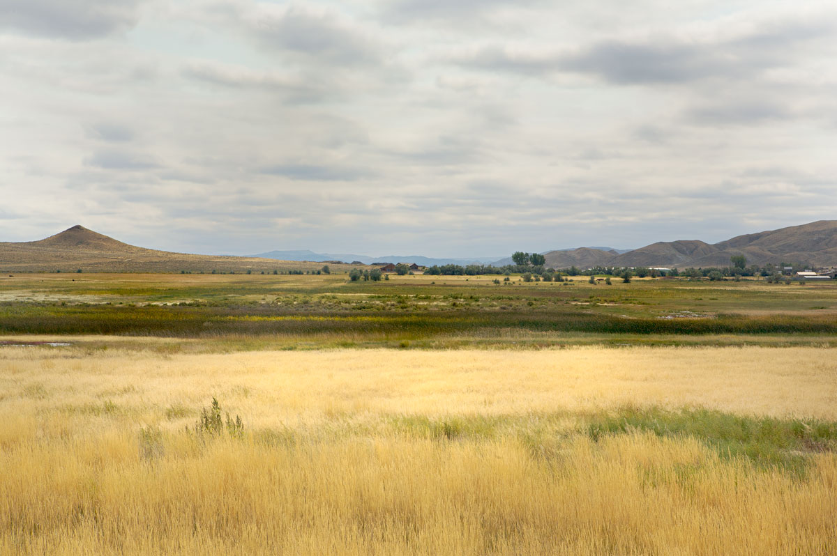 Photo of long sightlines under a brooding sky. — Wyoming