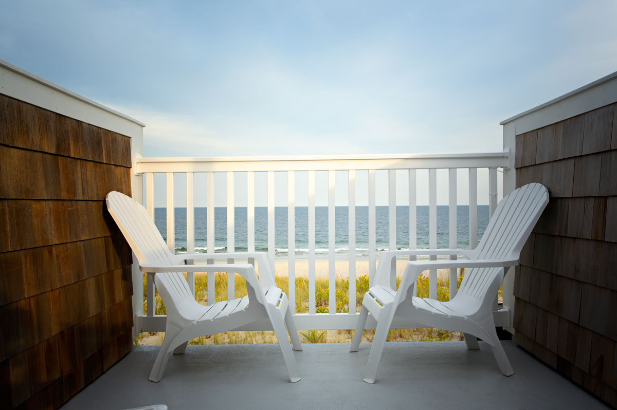 Photo of ocean front and adirondack chairs at the Island Beach Motor Lodge — South Seaside Park, New Jersey