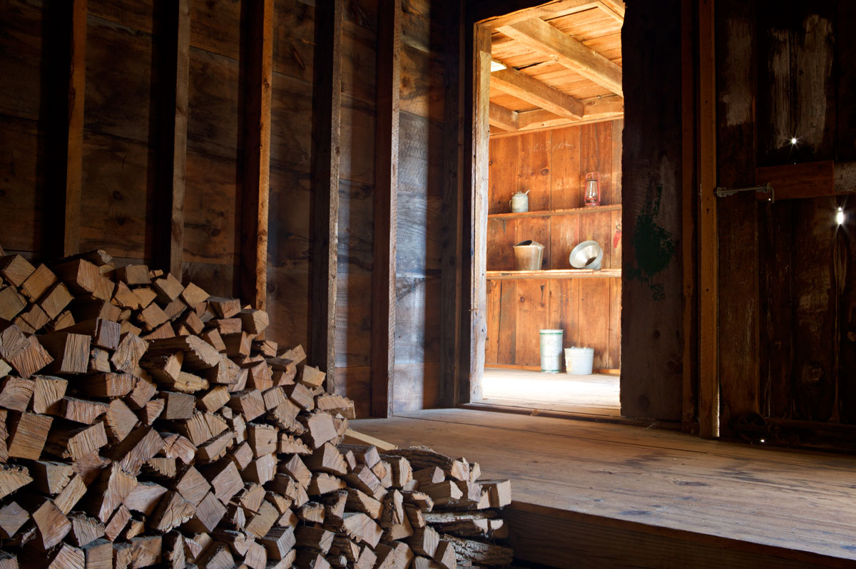 Photo of Woodpile at Frost farmhouse. — Derry, New Hampshire