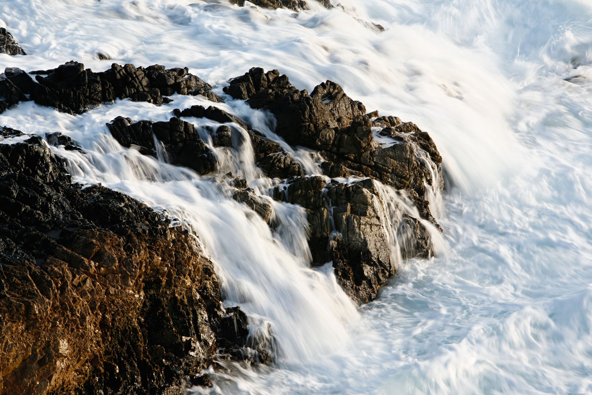 Photo of pacific surge on granite rocks — Big Sur, California